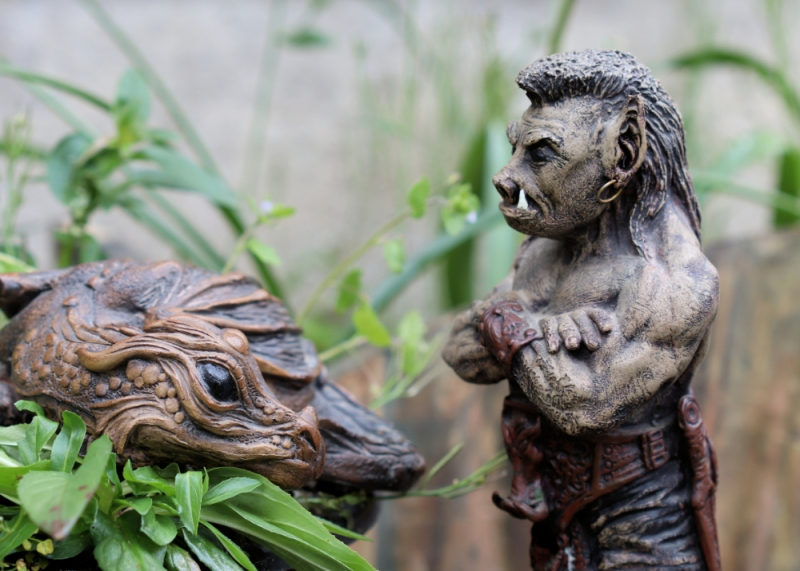 clay dragon and orc